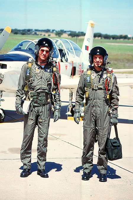 Student (on the right) and instructor after flying the TB-3 Epsilon trainer out of Beja. Both wear the HGU-55/P with boom microphone. Note the kidney protector on the instructor pilot.